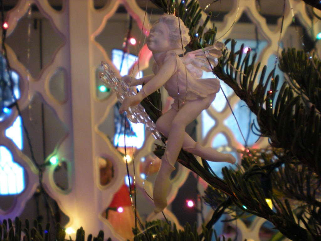 A photo of a snowflake fairy ornament