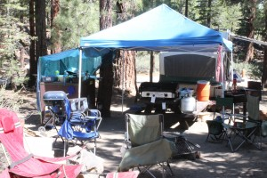 Our camp kitchen, and the back end of the pop-up trailer.
